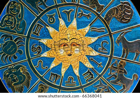 Zodiac signs in circle with golden sun - stock photo