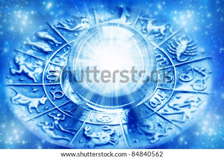 zodiac with astrological symbols and crystal ball with light - stock photo