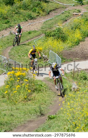 ZOETERMEER, THE NETHERLANDS - JULY 19, 2015: Dutch national MTB championships. Winner Michiel van der Heijden in the race. - stock photo