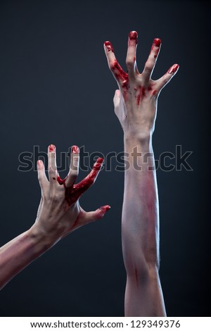 Zombie bloody hands, gray background - stock photo