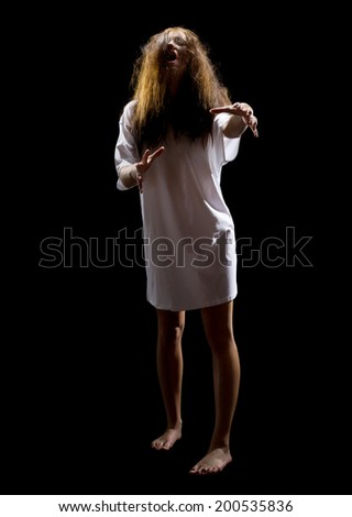Zombie girl isolated on black - stock photo