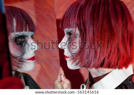 Dancer on pole performing acrobatic upside stock photo for Mirror zombie girl