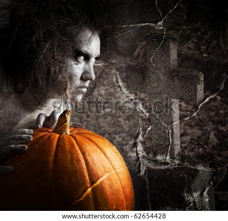 Zombie in the cemetery. Halloween theme. - stock photo