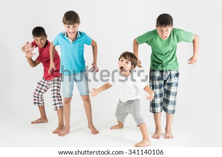 Zombie wannabe boys showing scary expression full body  - stock photo