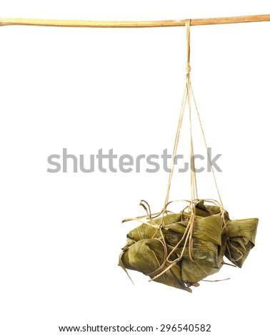 Zongzi - chinese sticky rice dumpling hang on wood against  white background - stock photo