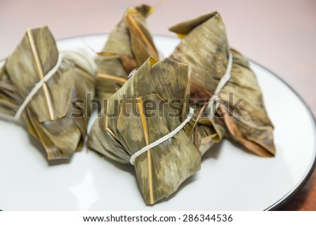 Zongzi in a plate. Zhongzi is a traditional Chinese food eaten during Dragon boat Festival - stock photo