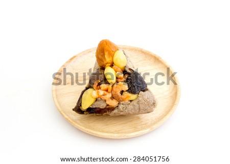 Zongzi or sticky rice dumpling in wood dish on white background - stock photo