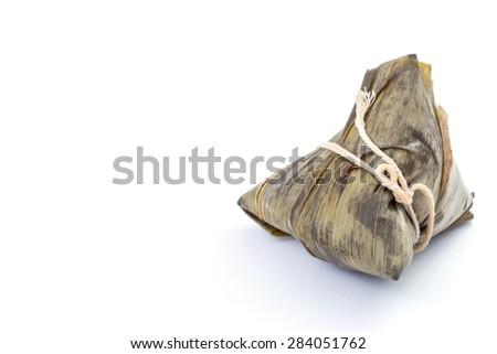 Zongzi or sticky rice dumpling on white background - stock photo