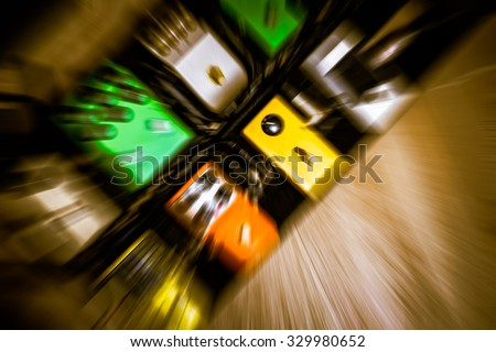 zoom blur guitar effect pedal, recording gear, multi color guitar signal processor in studio for music background - stock photo