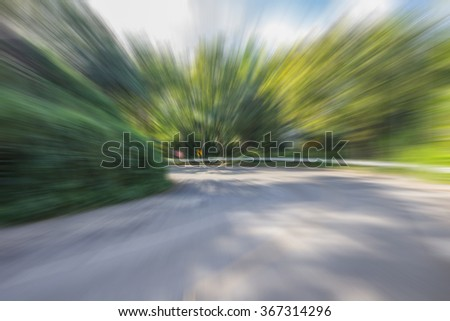 Zoom blur high speed motion at the curve road for abstract background. - stock photo