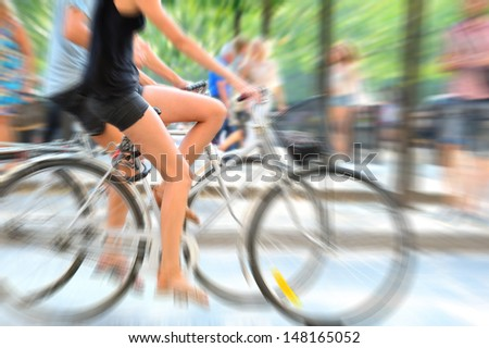 Zoom blurred bikes in profile - stock photo