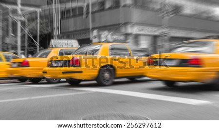 Zoomed and blurred view of New York yellow cabs isolated on black and white background. - stock photo