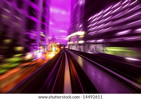 Zoomed into urban night traffics at dusk. Focus on the rail road. - stock photo