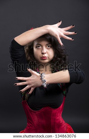 Zoomed woman hands pose in spanish flamenco dance