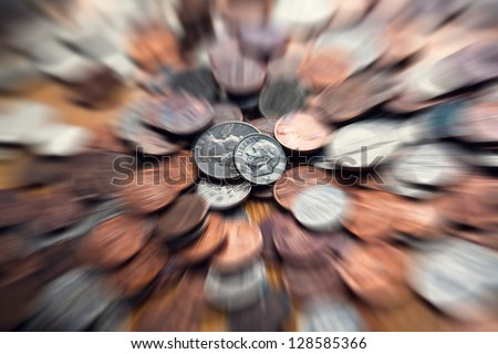 Zooming coins with motion blur. Financial / business  concept. - stock photo