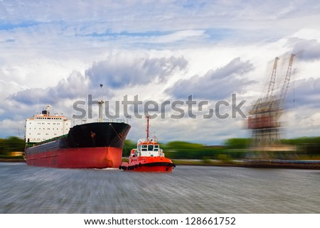 Zooming photo with a ship on the port. - stock photo
