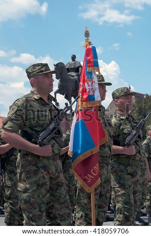 ZRENJANIN - MAY 9th:Flag of the Third Brigade of Serbian Army on Celebration a Victory Day and the Day of the Army of Serbia.May 9,2016 in Zrenjanin, Serbia - stock photo