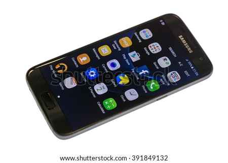 Zrenjanin, SERBIA March 15, 2016: Photo of Samsung Galaxy S7 against white. Samsung S7 is new generation smartphone from Samsung. The Samsung S7 is smart phone with multi touch screen. - stock photo