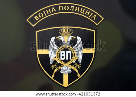 Zrenjanin, SERBIA: May 2016, Serbian Armed Forces Military Police Emblem sticked on Camouflage painted Armoured Personnel Carrier - stock photo