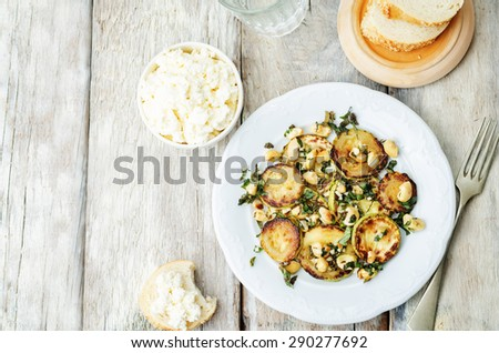 zucchini Basil mint cashews salad with ricotta and fresh bread. the toning. selective focus - stock photo