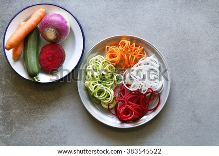 Zucchini,carrot,turnip and beetroot noodles on a plate.Top view. - stock photo
