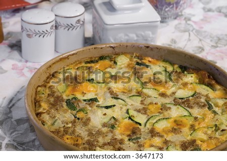 Zucchini Casserole made with Sausage, Cheese, and Onions. - stock photo