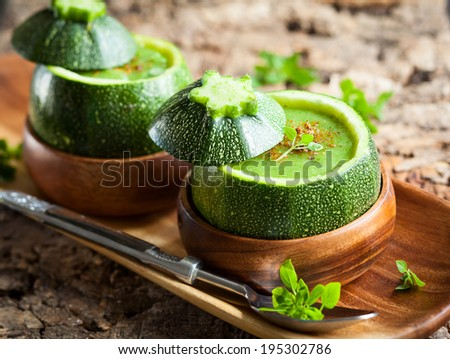 Zucchini cream soup served in a round zucchini - stock photo