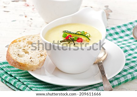 Zucchini cream soup with garlic and chilli - stock photo
