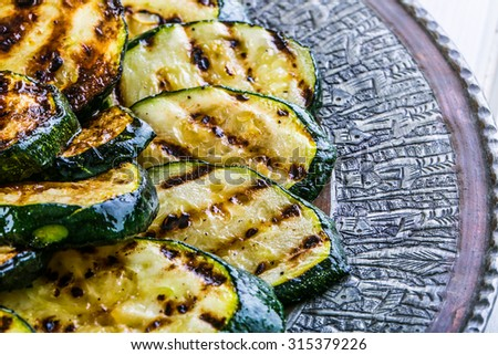 Zucchini.  Grilled zucchini. Slices of grilled zucchini on a plate. Vegetarian - Mediterranean cuisine. - stock photo