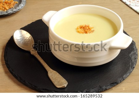 Zucchini or courgette soup served with dry fried onions - stock photo