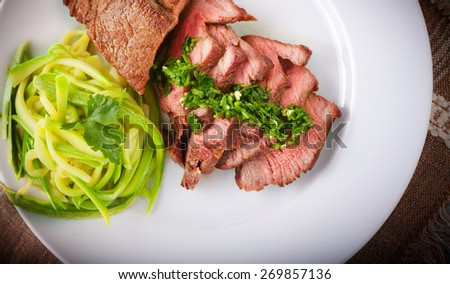 Zucchini pasta and meat - stock photo