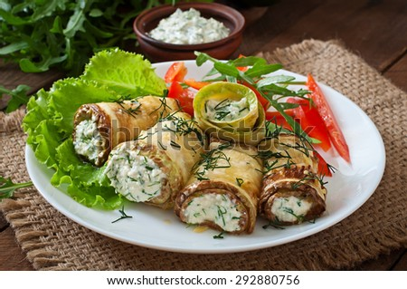 Zucchini rolls with cheese and dill - stock photo