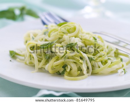 Zucchini Spaghetti with cheese, garlic and basil. Selective focus