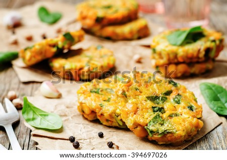 zucchini spinach chickpea burgers on a dark wood background. toning. selective focus - stock photo