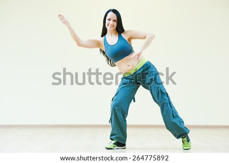 zumba firness instructor doing dancing exercises in sport club - stock photo