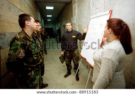 ZUNOVNICA,  BOSNIA, 12 DECEMBER 1997 - Former United States military officers, under contract from L-3 MPRI,  train Bosnian and Croatian  soldiers at a joint operations center in Bosnia. - stock photo