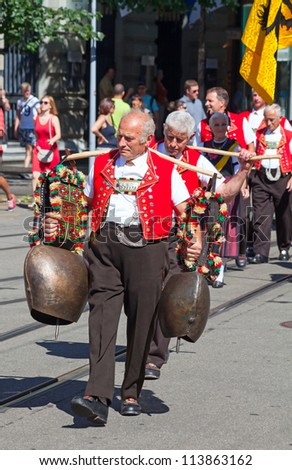 ZURICH - AUGUST 1: Representatives of cantone Appenzeller participating in the Swiss National Day parade on August 1, 2009 in Zurich, Switzerland. - stock photo
