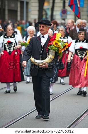 ZURICH - AUGUST 1: Swiss National Day parade on August 1, 2009 in Zurich, Switzerland. Representative of cantons in the national costumes. - stock photo