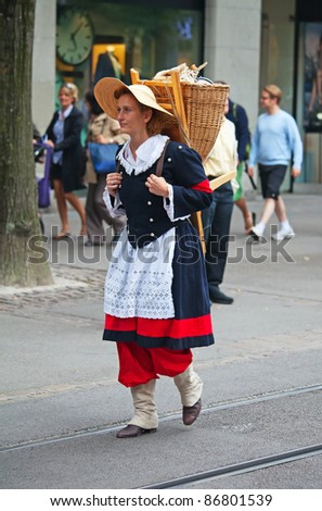 ZURICH - AUGUST 1: Woman in national costume taking part in Swiss National Day parade on August 1, 2011 in Zurich, Switzerland. - stock photo