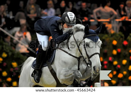ZURICH - JANUARY 31: Carsten-Otto Nagel (GER) in action during the ROLEX FEI World Cup on January 31, 2010 in Zurich. - stock photo