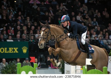 ZURICH - JANUARY 25, 2009: Michel Robert (FRA), during the ROLEX FEI World Cup, in Switzerland. - stock photo
