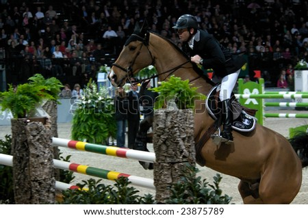 ZURICH - JANUARY 25, 2009: Phelippe Rozier (FRA), during the ROLEX FEI World Cup, in Switzerland. - stock photo