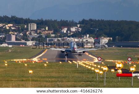 ZURICH - JULY 18: Boeing-737 British Airways landing in Zurich after short haul flight on July 18, 2015 in Zurich, Switzerland. Zurich airport is home for Swiss Air and one of biggest european hubs. - stock photo