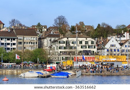 Zurich, Switzerland - 13 April, 2015: the Limmatquai quay during the Sechselauten parade. The Sechselauten is a traditional spring holiday in Zurich, usually celebrated on the 3rd Monday of April.