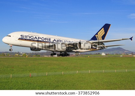 Zurich/Switzerland August 10, 2013: A380 from Singapore Airliners landing at Zürich Airport. - stock photo
