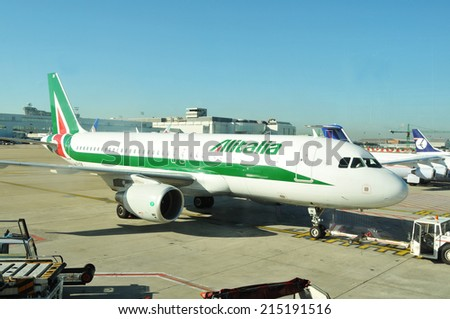 ZURICH, SWITZERLAND - AUGUST 30, 2010: Alitalia airplane preparing to take off from Zurich airport