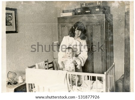 ZVOLEN, CZECHOSLOVAK REPUBLIC, CIRCA 1974 - Young mother and her child - circa 1974 - stock photo