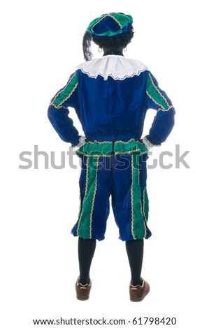"Zwarte Piet is looking away. Zwarte Piet is a Dutch tradition during ""Sinterklaas"", which is celebrated in December the fifth. - stock photo"