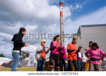 "ZWENTENDORF, AUSTRIA - JUNE 1: Improvised music show near the Zwentendorf Nuclear Power Plant during the ecological festival ""Tomorrow"" on June 1, 2013. The 1st austrian atomic plant was built in 1976"
