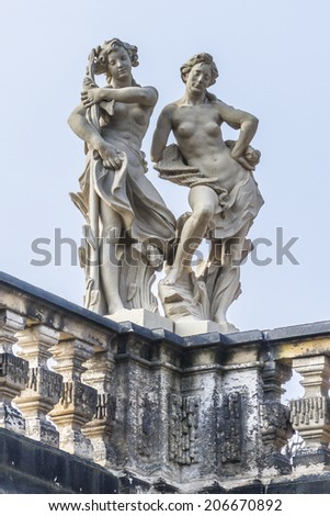 Zwinger is a palace in Dresden, eastern Germany, built in Rococo style in 17th century. Designed by court architect Matthaus Daniel Poppelmann. Nymphenbad (Nymph Bath) Sculptures. - stock photo